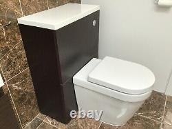 Bathroom sink with wall hung vanity unit and back to wall toilet with unit