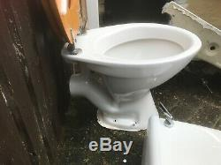 Bathroom white china toilet and vanity sink in good condition